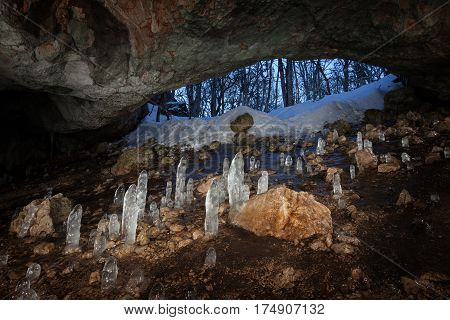The Cave with stalagmites of the ice