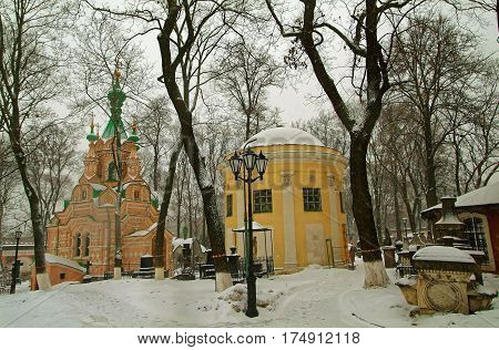 the tomb near the Orthodox Church in the snow in the Moscow monastery