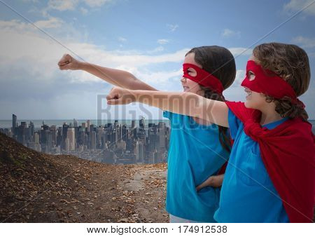 Digital composition of kids in superhero costume pretending to fly against cityscape