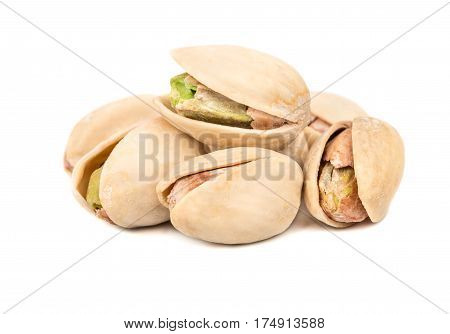 Several pistachio nuts on a white background