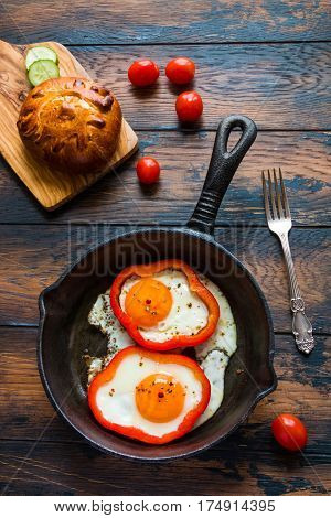 Fried Eggs And Bell Pepper In Black Iron-cast Skillet, Fresh Tomatoes And Bread. Top View.