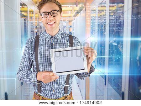 Digital composition of man holding digital tablet against server room in background