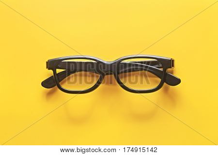 Black Glasses On A Yellow Background