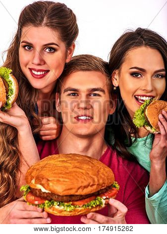 Group hamburger fast food with ham in people hands . Fast food concept. Man and women on eating party.
