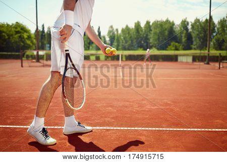 Serving tennis ball at dross court
