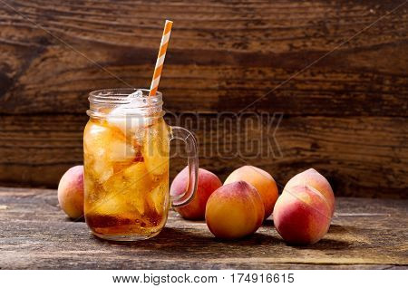 Jar Of Peach Iced Tea With Fresh Fruits