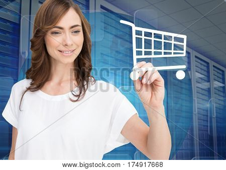 Digital composition of woman drawing shopping cart sign on screen against server room in background