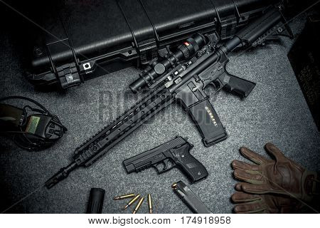 assault rifle on the floor with equipment