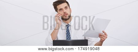 Man Holding Phone And Documents