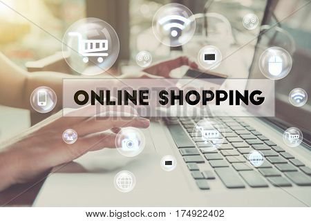 business hand holding credit card with computer and word Online shopping. can used for cover page presentation and web banner. e-commerce internet technology concept.