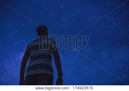 Man watching the night sky and stargazing.