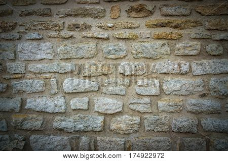 Gray brick wall texture background with vignetted corners