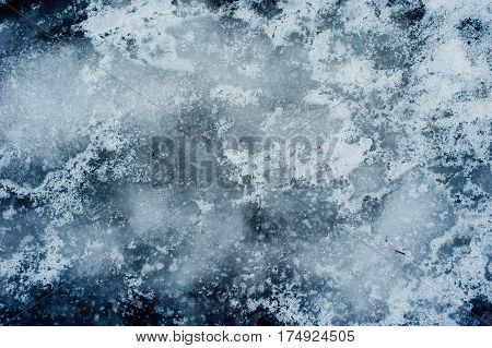 Cold blue ice texture on a winter lake. Frost