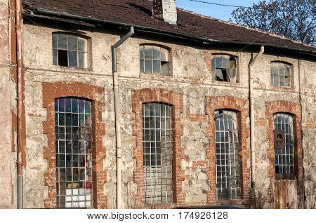 Glass iron windows of old grunge abandoned vintage industrial building