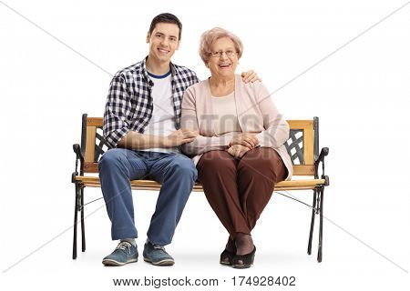 Young man and an elderly woman sitting on a bench and looking at the camera isolated on white background