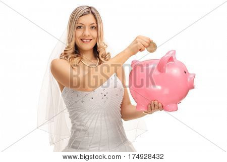 Young bride putting a coin into a piggybank isolated on white background