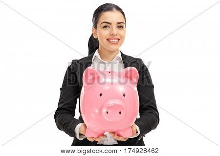 Happy businesswoman holding a piggybank isolated on white background