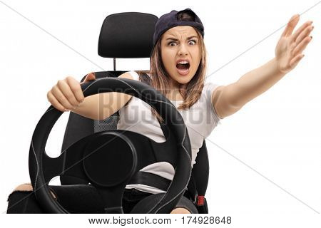 Angry teenage driver holding a steering wheel and gesturing with her hand isolated on white background