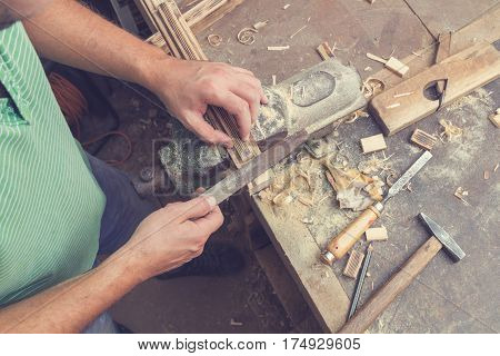 Carpenter's little working tools on a dusty table.
