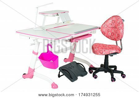 Pink chair pink school table pink basket desk lamp and black support under legs on the white isolated background.