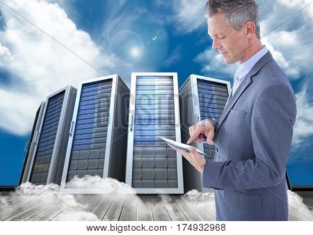 Digital composite image of businessman using digital tablet against server tower with cloudy background
