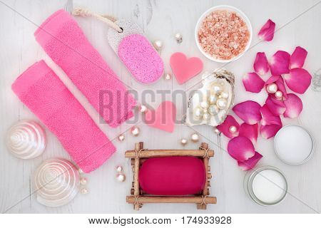 Rose petal spa  skincare beauty treatment with  himalayan salt, soap, flannels, moisturising cream, pumice with mother of pearl shells and pearls.