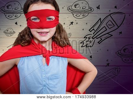 Digital composite image of girl pretending to be a superhero against wooden background