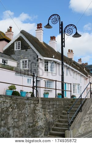 Architecture with lamppost in shape of fossil in Lyme Regis Dorset
