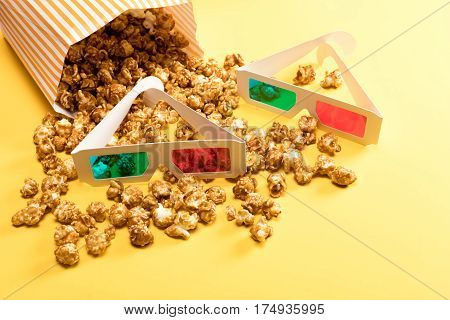 close up view of popcorn and 3D glasses on yellow Movie time concept