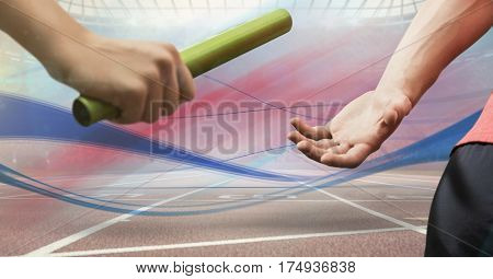 Digitally generated image of hands passing the baton in stadium