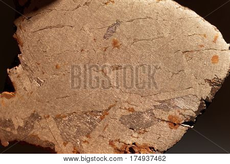 Macro photo of an iron meteorite with Widmanstaetten patterns.