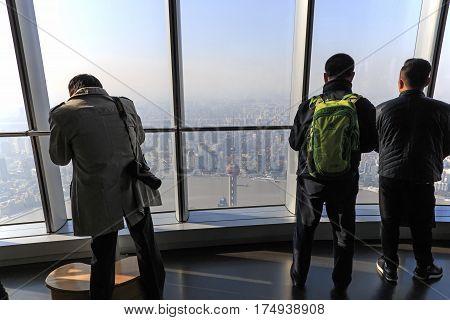 Shanghai, China - March 2, 2017: Tourists Enjoying The View Of Shanghai From The Of The Shanghai Tow