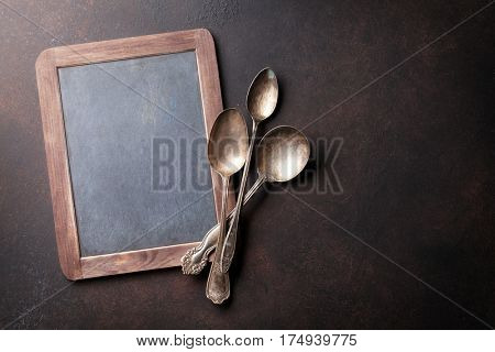 Old vintage kitchen utensils. Spoons and chalk board for your text