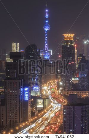Shanghai, China - March 2, 2017: Shanghai Skyline At Night With The Oriental Pearl Tower On Backgrou