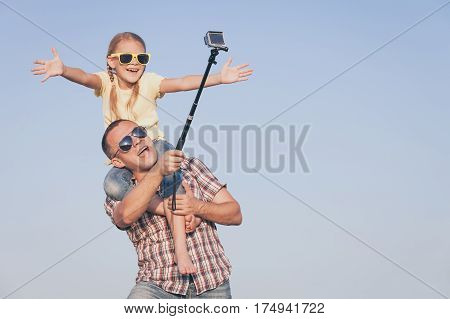 Father And Daughter Playing In The Park  At The Day Time.