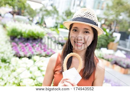 Woman holding Spanish churro in flower garden