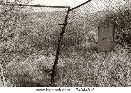 Rusty Metal Fence Along A Road Receding Into The Distance To The Old Abandoned Factory. The Crisis,