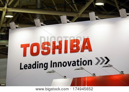 Moscow, Russia - February, 2016: Toshiba company logo on the wall. Toshiba is japanese producer of electronic components and materials, industrial infrastructure systems, consumer electronics, household appliances, medical equipment