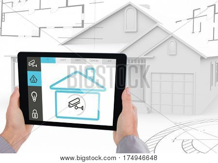 Digital composite image of hand holding a digital tablet with house security concept against digital house model in background