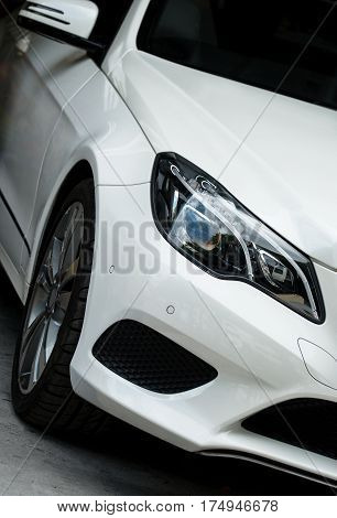 Close-up View Of White Sports Car Headlight.