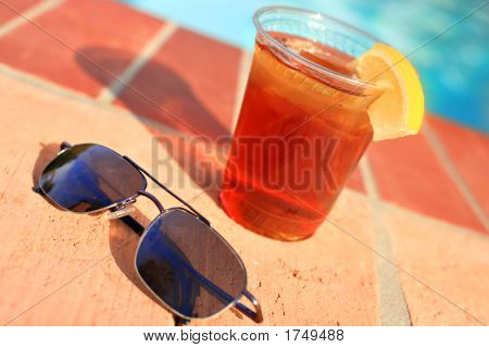 Iced Tea And Sunglasses By The Pool