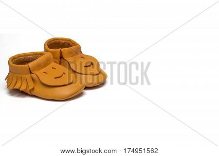 Childs Yellow Booties On A White Background