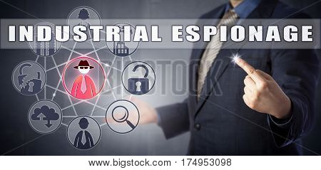 Male enterprise security agent in blue business suit is identifying an INDUSTRIAL ESPIONAGE incident. Computer crime concept for economic espionage corporate espionage and corporate spying.