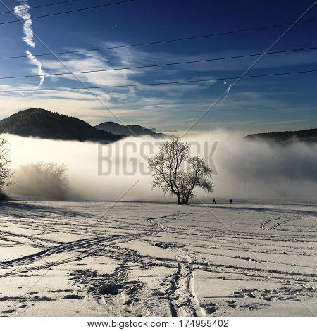 winter landscape view over the  alps,  snowy mountains, nature covered with snow at winter sunset. St. Moritz the Swiss Alps