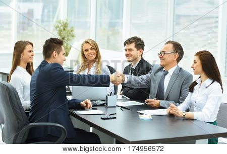 shaking hands during a business meeting business partners in the office