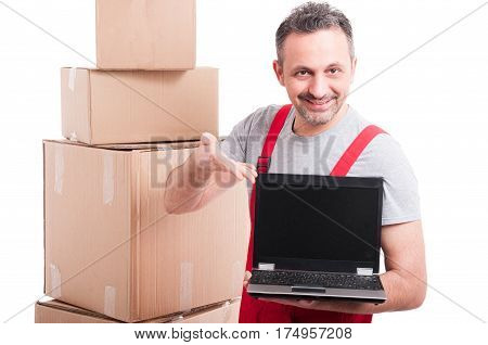 Mover Guy Holding And Showing Blank Screen Laptop
