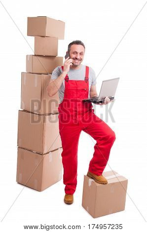 Full Body Of Mover Man Holding Laptop And Talking At Phone