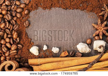 Coffee, Cinnamon, Vanilla, Nutmeg Scattered In Chaotic Manner On Black Background. Op View From Abov