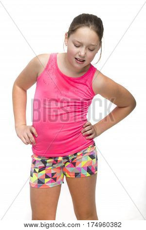A young tween girl is sweaty and tired from exercise.