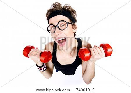 Funny thin man doing exercises with dumbbells. Bodybuilding, muscle building. Sports, activities concept. Isolated over white.